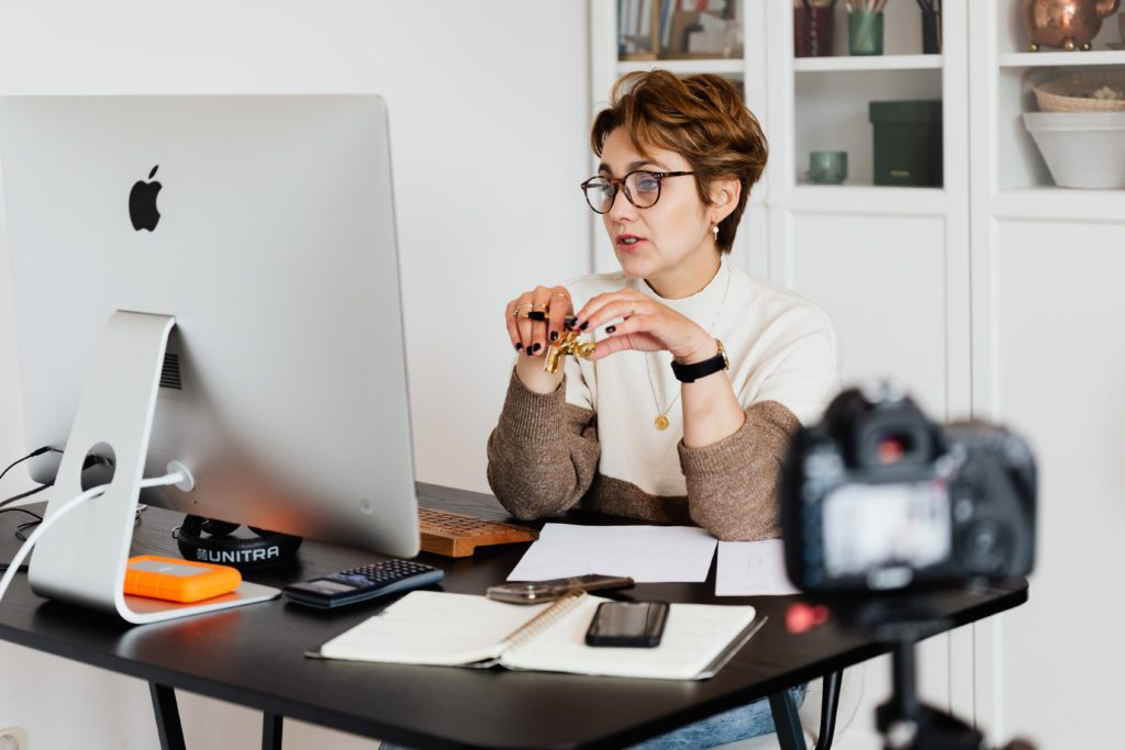 Woman doing a video live stream from home